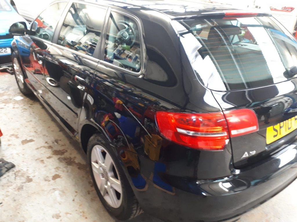 Black 2010 Audi A3 - rear side