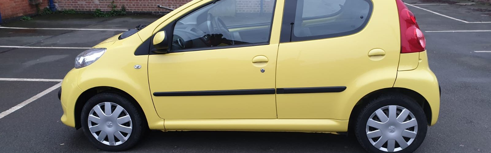 For Sale: Yellow Peugeot 107 - side view